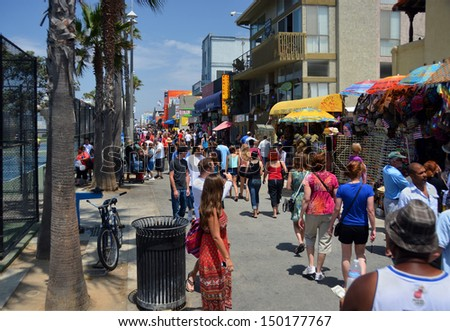 LOS ANGELES, USA - JULY 14, 2013: Crowds of visitors at the many stalls on Venice Beach boardwalk on July 14, 2013 in Los Angeles.