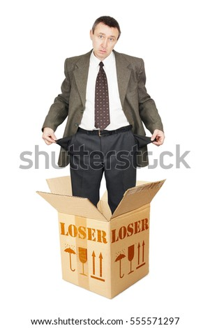 Loser appears out from the cardboard box and shows empty pockets. Isolated over white
