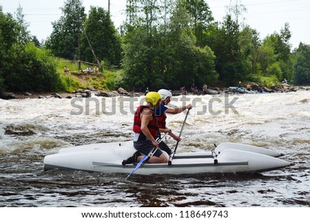 LOSEVO - 3 JULY: Unknown sportsmans on kayak on the rough Vuoksi River on July 3, 2011 in Losevo, Russia