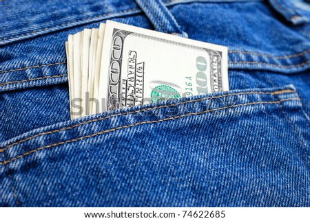 Lot of dollars in a pocket of jeans.