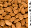 Lot of selected almonds close up - stock photo
