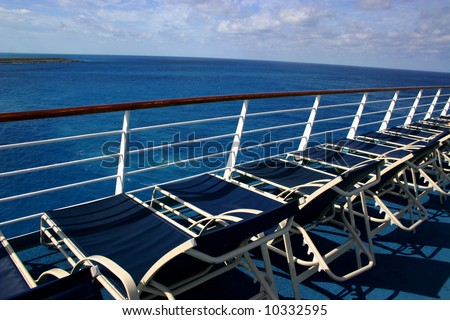 Lounge chairs on deck of cruise ship
