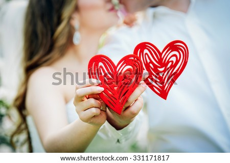 Love concept - Romantic couple kissing  and holding heart