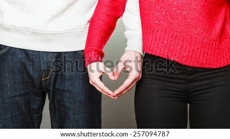 Love concept. Woman and man hands forming heart shape with their fingers