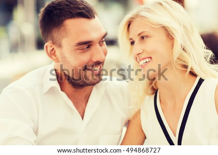 love, date, affection, people and relations concept - smiling happy couple outdoors