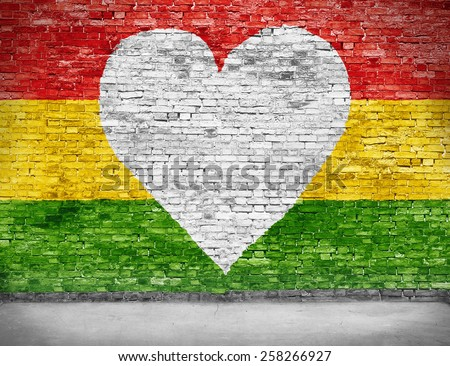 Love for reggae music loving painted over white brick wall