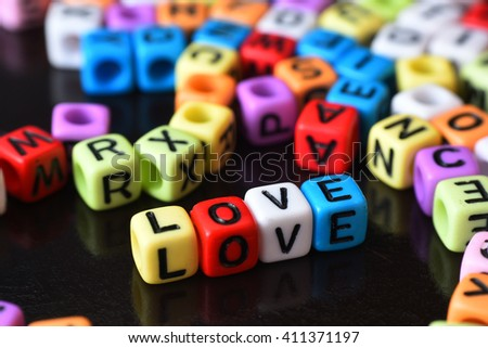 Love word written on colorful cube dice