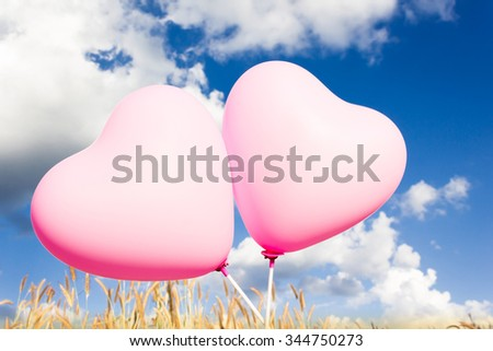 Lovely couple sweet  pink heart pattern balloons with clear blue sky background in concept of happiness and love