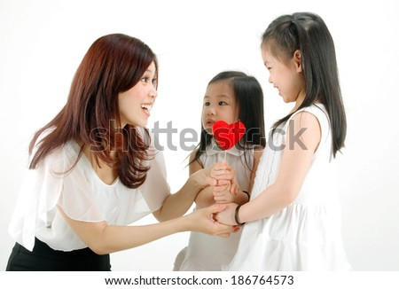 Lovely little girls giving a love shape to their mother on mothers day
