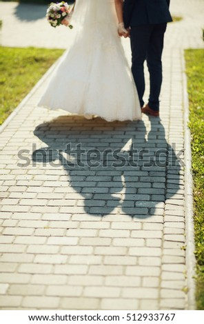 lovely married couple walking in the large garden