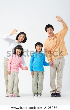 Lovely Smiling Family - raising hands in greeting