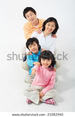Lovely Smiling Family with relaxing massage