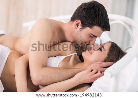 Loving Couple In Bed Beautiful Young Lying And Looking At Each
