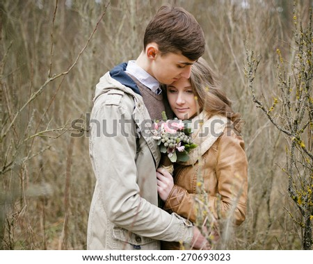 Loving couple in the forest in spring