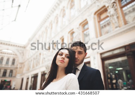 Loving couple posing in the old town