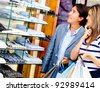 Loving couple shopping at a clothing store - stock photo