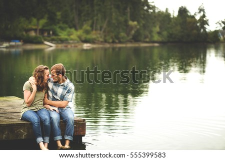 Loving Couple Sitting on a Dock