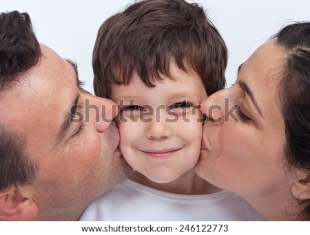 Loving family with a kid - parents kissing a little boy