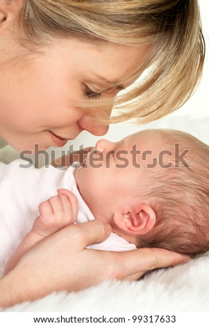 Loving moment of tenderness between a mother and her 18 days old baby