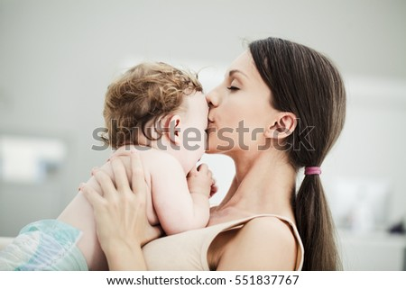 Loving mother kissing her baby boy.