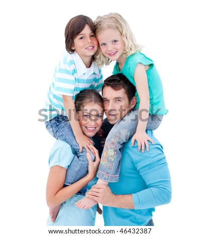 Loving parents giving their children piggyback ride against a white background