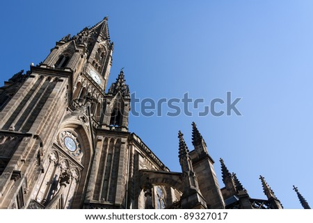 Low-angle shoot of an old cathedral and blue sky in the background