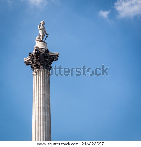Low angle view of the London landmark Nelson's Column set against blue sky copy space.