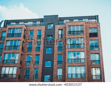 Modern Brick Apartment Building low angle architectural exterior modern commerical stock photo