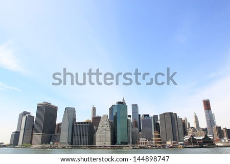 Lower Manhattan Skyline and Skyscrapers on a Clear Blue Sky from Brooklyn, New York City