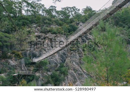 Lower view of rope suspension bridge between rocks in Goynuk canyon in Turkey
