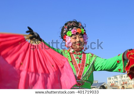 Luannan County- February 16: Chinese traditional style yangko folk dance performance in the street, on February 16, 2016, luannan County, hebei Province, China