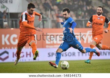 LUBIN, POLAND - DECEMBER 19, 2016: Match Polish Premier League Lotto Ekstraklasa between KGHM Zaglebie Lubin - Piast Gliwice 2:1. In action Sebastian Madera (L) and Gerard Badia (R).