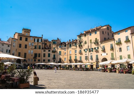 LUCCA, ITALY - AUGUST 18: Piazza dell'Anfiteatro, one of main city attraction was built on the ruins of the ancient Roman amphitheatre, on August 18, 2013 in Lucca, Italy