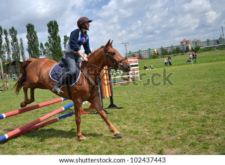 LUCENEC, SLOVAKIA MAY 13: Unidentified rider competes at the Hosrse Day Show 2012 on May 13, 2012 in Lucenec, Slovakia