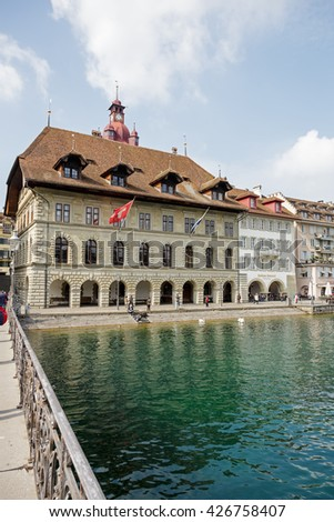 LUCERNE, SWITZERLAND - MAY 02, 2016: Town Hall was built in the early 1600s, it is impressive building by the river Reuss.