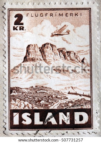 LUGA, RUSSIA - APRIL 12, 2016: A stamp printed by ICELAND shows aircraft over Iceland Landscape, circa 1947
