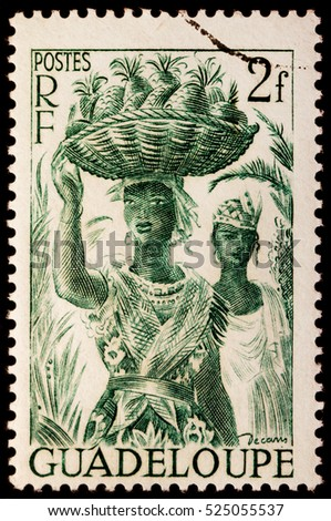 LUGA, RUSSIA - NOVEMBER 06, 2016: A stamp printed by GUADELOUPE shows image portraits of two young Guadeloupe women, circa 1947