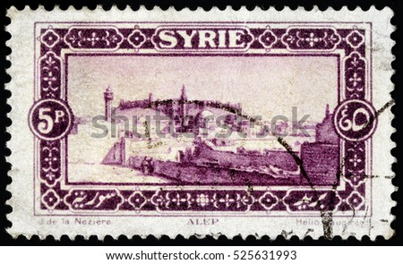 LUGA, RUSSIA - NOVEMBER 29, 2016: A stamp printed by SYRIA shows view of Aleppo - a city in Syria, serving as the capital of the Aleppo Governorate, circa 1925