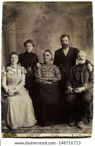 LUGANSK, RUSSIAN EMPIRE - CIRCA 1900s: Studio portrait  of family, photo studio by S. Umannsky, Lugansk, Ukraine, 1900s