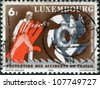 LUXEMBOURG - CIRCA 1980: A stamp printed in Luxembourg, is dedicated to 9th World Congress on Prevention of Occupational Accidents & Diseases, Amsterdam, shows a Man, hand, gears, circa 1980 - stock photo