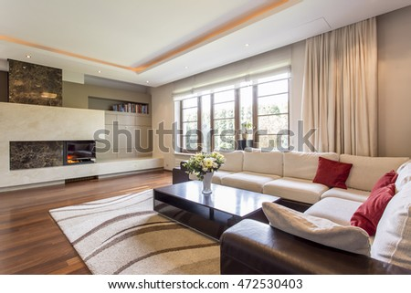 Luxurious Living Room In A Villa With Leather Corner Sofa And Fireplace