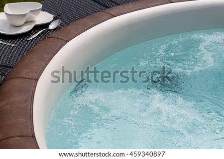 Luxurious standalone hot tub or jacuzzi with hot bubbling water