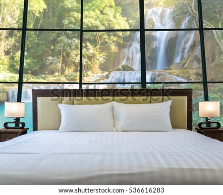 Luxury Interior bedroom with windows glass beside Beautiful waterfall in the deep forest, relax and holiday concept, dicut each elements