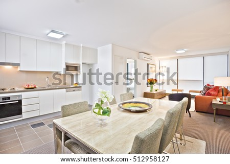 Luxury Kitchen With White Dining Table And Sofa Wash Basin Gas Cooker Have Attached