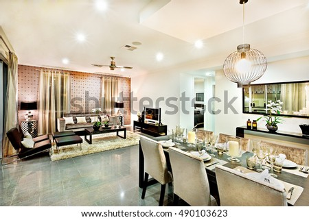 Luxury Living Room And Dining Area With Hanging Lights Including Chairs Tables Beside The Television