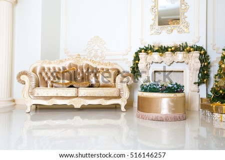 Luxury living room interior decorated with chic Christmas tree.