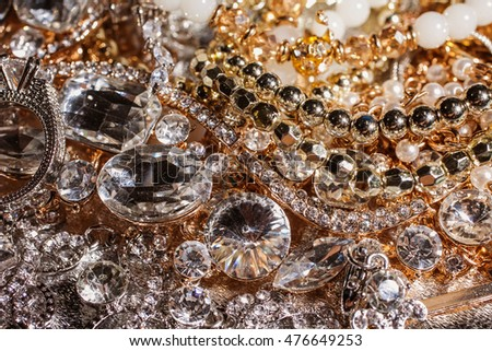 Luxury precious background of close up of golden and silver jewelry