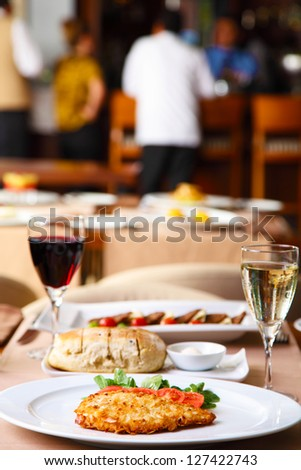 Luxury restaurant table with wine and dinner
