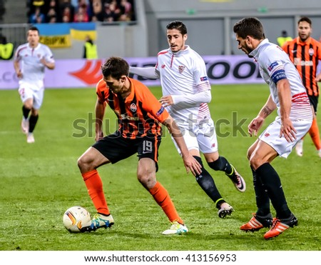 LVIV, UKRAINE - APRIL, 28th - 2016: Shakhtar Donetsk players (In orange) in the fight of ball with FC Sevilla Players during the UEFA EUROPE LEAGUE 1-st Semi-Final match at Arena Lviv stadium