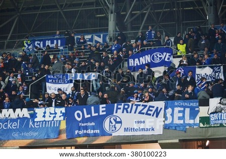 LVIV, UKRAINE - FEB 18: Active German Schalke fans in the stands during the UEFA Europa League match between Shakhtar vs Schalke 04, 18 February 2016, Arena Lviv, Ukraine